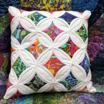 Image of pillow made from the cathedral window pillow class